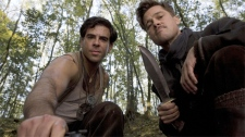 Eli Roth as Sgt. Donnie Donowitz and Brad Pitt as Lt. Aldo Raine in Universal Pictures' 'Inglorious Basterds'