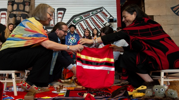 Commissioners Marion Buller (left) and Commissioner Michele Audette prepare the official copy of the report for presentation to the government during ceremonies marking the release of the Missing and Murdered Indigenous Women report in Gatineau, Monday June 3, 2019. THE CANADIAN PRESS/Adrian Wyld