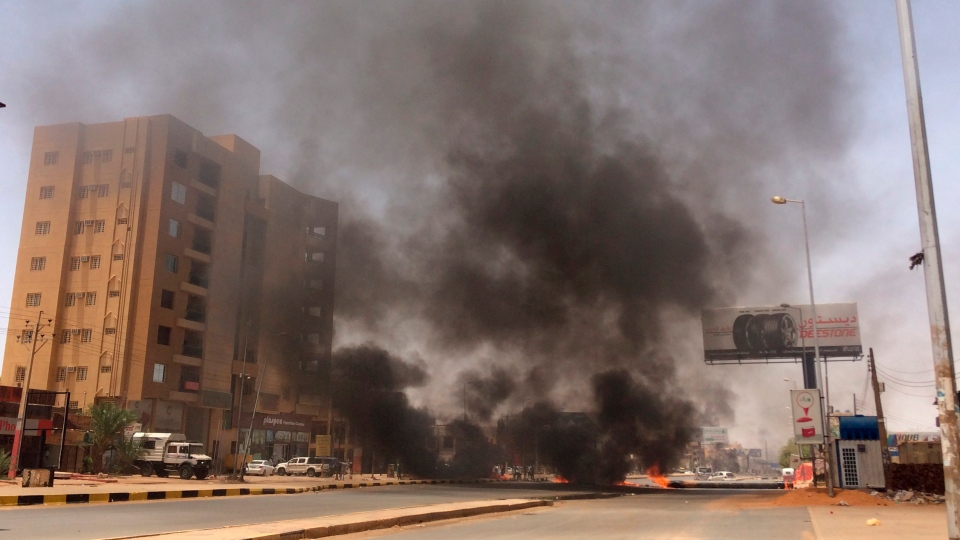 Burning tires set by protesters produce black smoke on road 60, near Khartoum's army headquarters, in Khartoum, Sudan, Monday, June 3, 2019.(AP Photo)