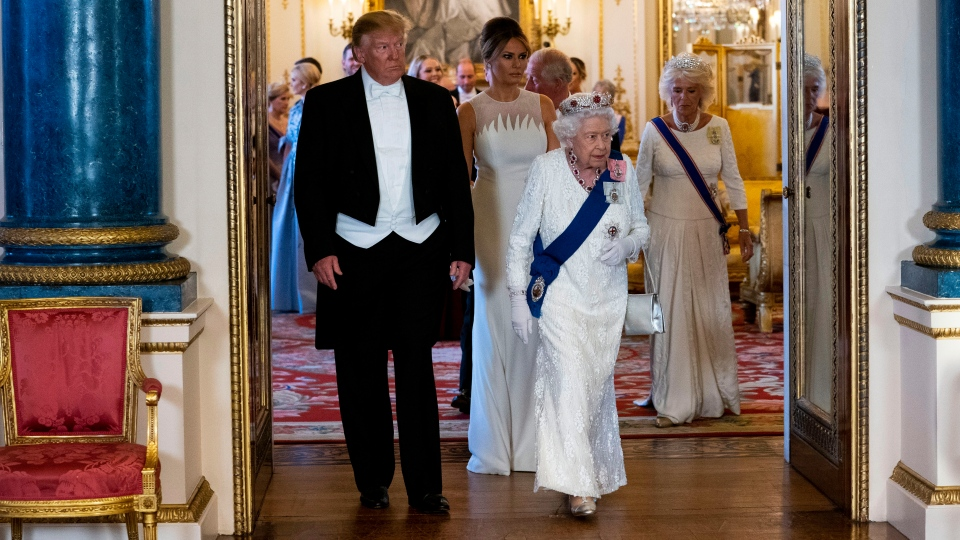 U.S. President Donald Trump and first lady Melania Trump walk with Queen Elizabeth II as they make their way into the Music Room for a State Banquet at Buckingham Palace, Monday, June 3, 2019, in London. (Doug Mills/Pool Photo via AP)