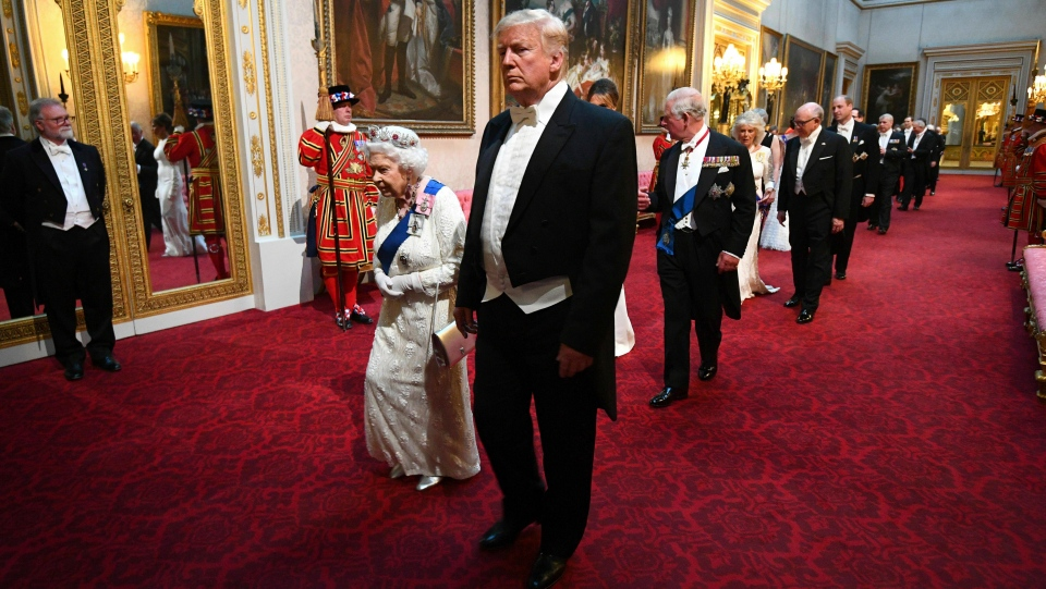 Queen Elizabeth II, U.S. President Donald Trump, first lady Melania Trump, and Prince Charles arrive through the East Gallery ahead of the State Banquet at Buckingham Palace in London, Monday, June 3, 2019. (Victoria Jones/Pool Photo via AP)