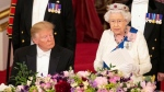 U.S. President Donald Trump, left, listens as Queen Elizabeth II delivers a speech, during the State Banquet at Buckingham Palace, in London, Monday, June 3, 2019. Trump is on a three-day state visit to Britain. (Dominic Lipinski/Pool Photo via AP)