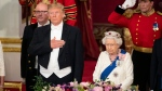 U.S, President Donald Trump , left and Queen Elizabeth stand, during the State Banquet at Buckingham Palace, in London, Monday, June 3, 2019. Trump is on a three-day state visit to Britain. (Dominic Lipinski/Pool Photo via AP)