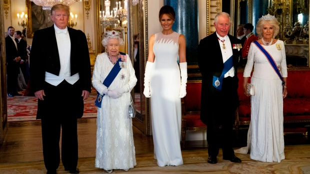 From left, U.S. President Donald Trump, Queen Elizabeth II, first lady Melania Trump, Prince Charles and Camilla, the Duchess of Cornwall pose for the media ahead of the State Banquet at Buckingham Palace in London, Monday, June 3, 2019. Trump is on a three-day state visit to Britain. (Doug Mills / Pool Photo via AP)
