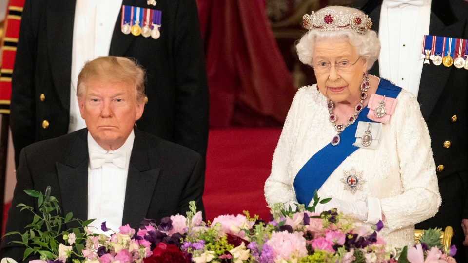 U.S. President Donald Trump, left, listens as Britain's Queen Elizabeth II delivers a speech, during the State Banquet at Buckingham Palace, in London, Monday, June 3, 2019.  (Dominic Lipinski/Pool Photo via AP)