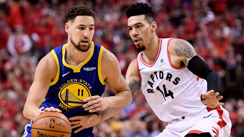 Toronto Raptors guard Danny Green (14) pressures Golden State Warriors guard Klay Thompson (11) as he drives down court during first half game 2 NBA Finals action, in Toronto on Sunday, June 2, 2019. THE CANADIAN PRESS/Frank Gunn