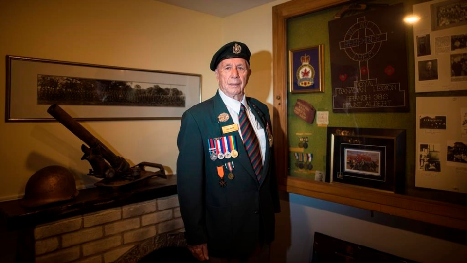 D-Day veteran Jim Parks, 94, poses for a photograph at the Mount Albert Legion in Newmarket, Ont., on Thursday, May 30, 2019. THE CANADIAN PRESS/ Tijana Martin