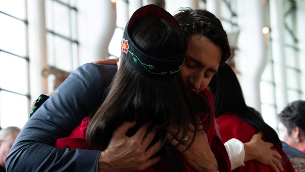 A woman is embraced by Canadian Prime Minister Justin Trudeau during ceremonies marking the release of the Missing and Murdered Indigenous Women report in Gatineau, Monday June 3, 2019. THE CANADIAN PRESS/Adrian Wyld