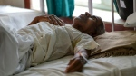 A patient stricken by heat exhaustion recovers in a hospital in Churu, Rajasthan where temperatures have hit 50 degrees Celsius (122 Fahrenheit) (AFP)