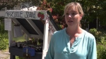 Katherine Little at her Little Stand produce table in front of her Saanich home. (CTV Vancouver Island)