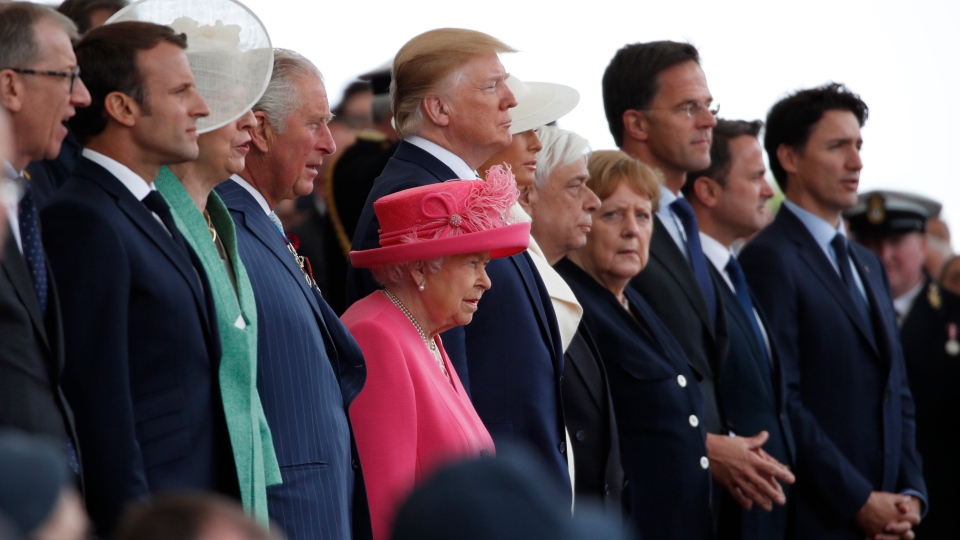 Queen Elizabeth II and World leaders stand during an event to mark the 75th anniversary of D-Day, Wednesday, June 5, 2019, in Portsmouth, England. (AP Photo/Alex Brandon)