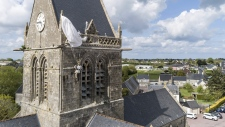 A dummy hangs on the Sainte Mere Eglise bell tower