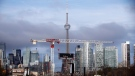 Condominiums and the CN Tower are shown along the Toronto skyline on Tuesday, April 25, 2017. THE CANADIAN PRESS/Cole Burston