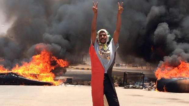 A protester flashes the victory sign in Sudan