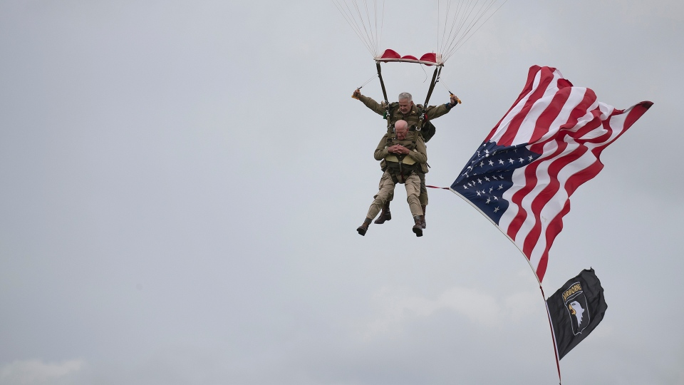 U.S. World War II D-Day veteran Tom Rice, from Coronado, CA, parachutes in a tandem jump into a field in Carentan, Normandy, France, Wednesday, June 5, 2019. (AP Photo)