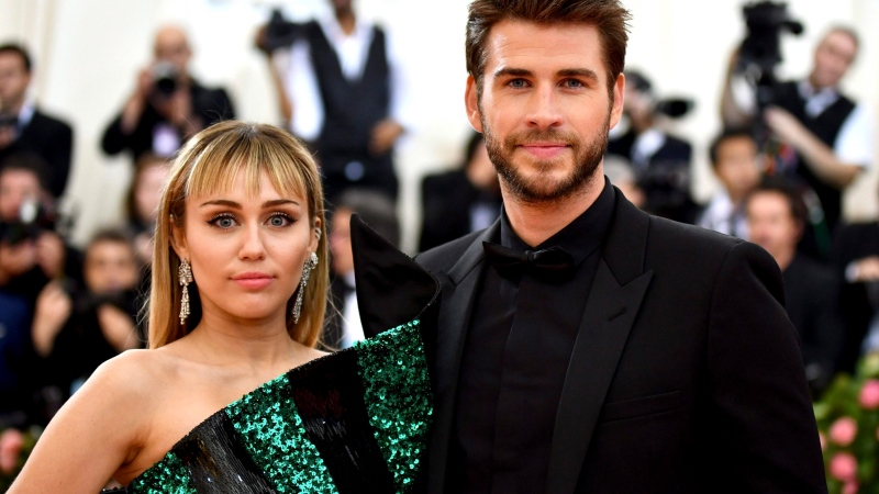 "Miley Cyrus, left, and Liam Hemsworth attend The Metropolitan Museum of Art's Costume Institute benefit gala celebrating the opening of the ""Camp: Notes on Fashion"" exhibition on Monday, May 6, 2019, in New York. (Photo by Charles Sykes/Invision/AP)"