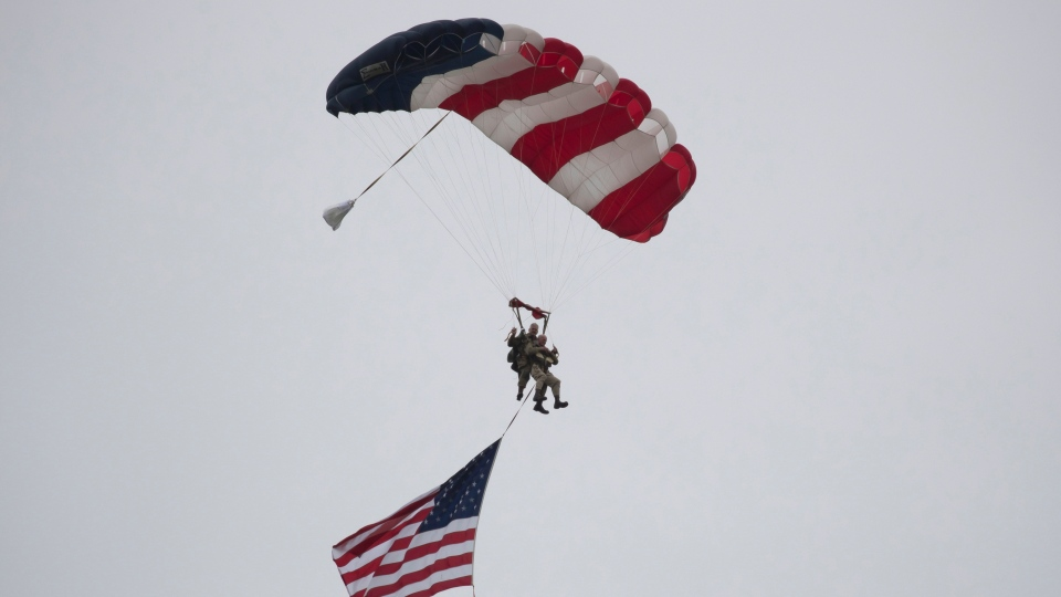 U.S. Second World War D-Day veteran Tom Rice parachutes in a tandem jump into a field in Carentan, Normandy, France, on June 5, 2019. (AP)