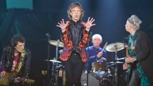 In this Oct. 22, 2017 file photo, from left, Ronnie Wood, Mick Jagger, Charlie Watts and Keith Richards of the Rolling Stones perform during the concert of their 'No Filter' Europe Tour 2017 at U Arena in Nanterre, outside Paris, France. (AP Photo/Michel Euler, File)