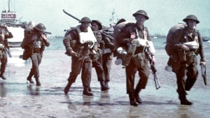 Canadian soldiers making their way inland on June 6, 1944. (Source: Library Archives Canada and the Juno Beach Centre Association)