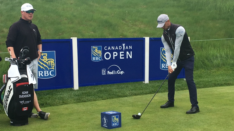 St. Thomas-native Jace Walker, left, caddies for Adam Svensson at practice ahead of the RBC Canadian Open in Ancaster, Ont. on Wednesday, June 5, 2019. (Brent Lale / CTV London)