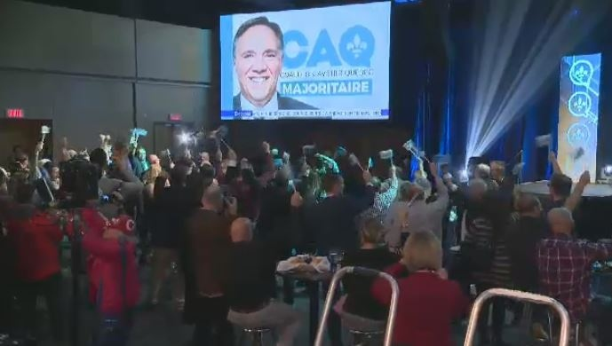 Supporters celebrate a CAQ majority government in the 2018 election.