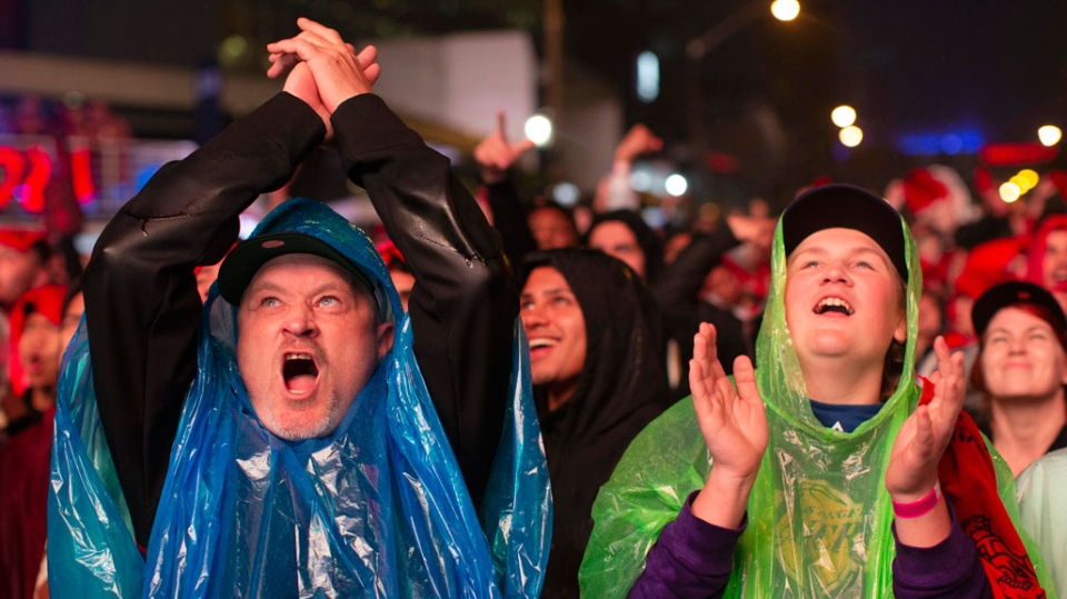"Toronto Raptors fans react as they watch game 3of the NBA Final between Toronto Raptors and Golden State Warriors in ""Jurassic Park'' fanzone outside of Scotiabank Arena in Toronto on Wednesday June 5, 2019. (THE CANADIAN PRESS/Chris Young )"