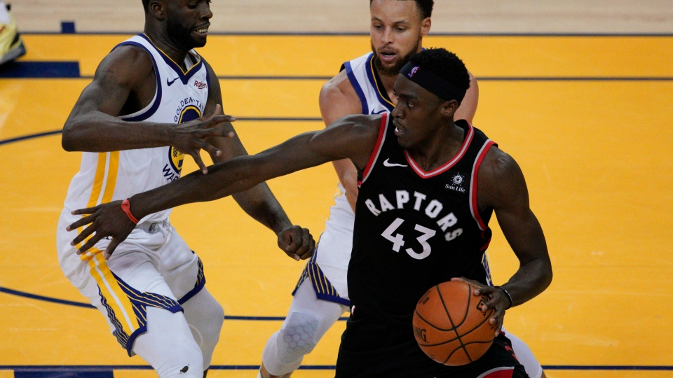 Toronto Raptors forward Pascal Siakam (43) is defended by Golden State Warriors forward Draymond Green, left, and guard Stephen Curry during the second half of Game 3 of basketball's NBA Finals in Oakland, Calif., Wednesday, June 5, 2019. (AP Photo/Tony Avelar)
