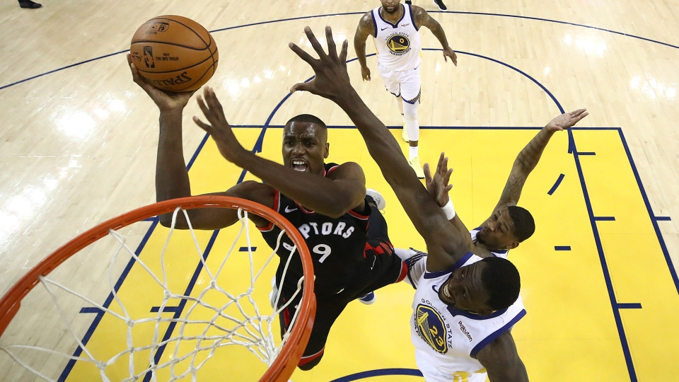 Toronto Raptors center Serge Ibaka (9) shoots against the Golden State Warriors during the first half of Game 3 of basketball's NBA Finals in Oakland, Calif., Wednesday, June 5, 2019. (AP Photo/Ezra Shaw, Pool)