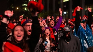 """Toronto Raptors fans react as they watch Game 3 of the NBA Final between Toronto Raptors and Golden State Warriors in """"Jurassic Park'' fanzone outside of Scotiabank Arena in Toronto on Wednesday June 5, 2019. (THE CANADIAN PRESS/Chris Young)"""