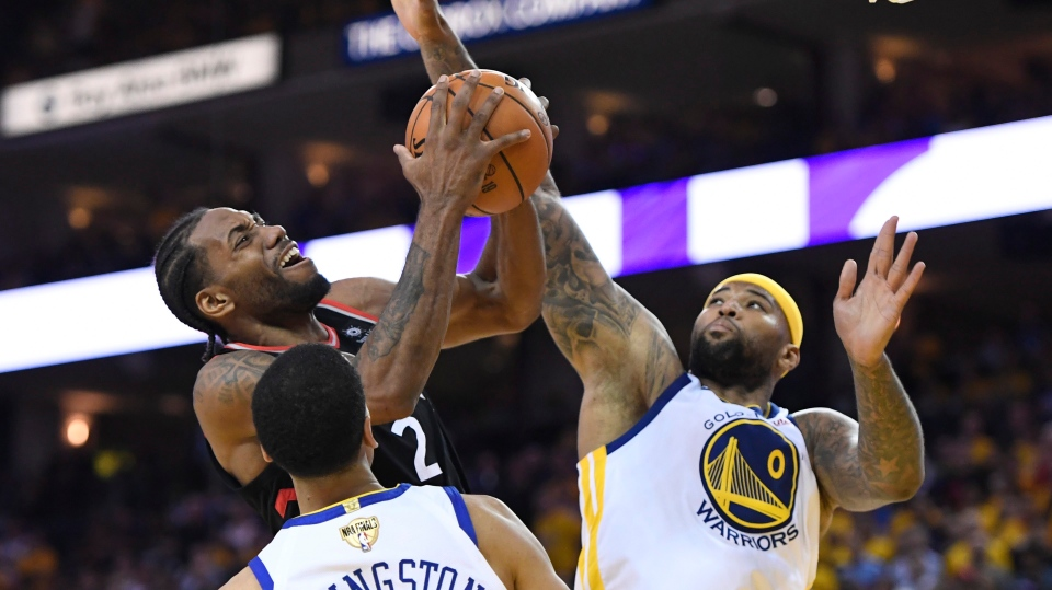 Toronto Raptors forward Kawhi Leonard (2) jumps for the basket as Golden State Warriors centre DeMarcus Cousins (0) defends during second half basketball action in Game 3 of the NBA Finals in Oakland, California on Wednesday, June 5, 2019. THE CANADIAN PRESS/Frank Gunn
