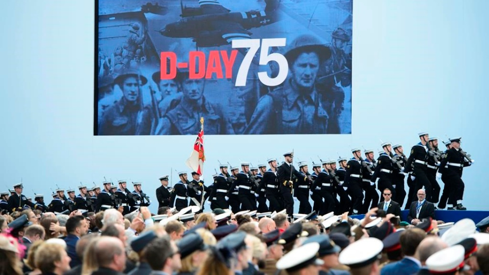 Soldiers march on stage during the D-Day 75th Anniversary British International Commemorative Event at Southsea Common in Portsmouth, England on Wednesday, June 5, 2019. THE CANADIAN PRESS/Sean Kilpatrick