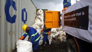 Workers load garbage which was collected from Mount Everest in trucks in Kathmandu, Nepal, Wednesday, June 5, 2019. Officials in Nepal say a government expedition to Mount Everest has removed 11,000 kilograms (24,200 pounds) of garbage and four dead bodies from the world's highest mountain. (AP Photo/Bikram Rai)