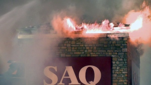 Flames erupt from an SAQ building on Sainte-Anne Blvd. in Sainte-Anne-des-Plaines on June 6, 2019 (CTV Montreal/Cosmo Santamaria)