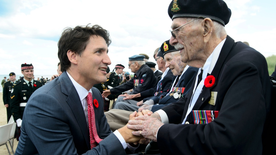 Prime Minister Justin Trudeau shakes hands with Veteran of the Second World War Bill Anderson as they visit Juno Beach following the D-Day 75th Anniversary Canadian National Commemorative Ceremony at Juno Beach in Courseulles-Sur-Mer, France on Thursday, June 6, 2019. THE CANADIAN PRESS/Sean Kilpatrick
