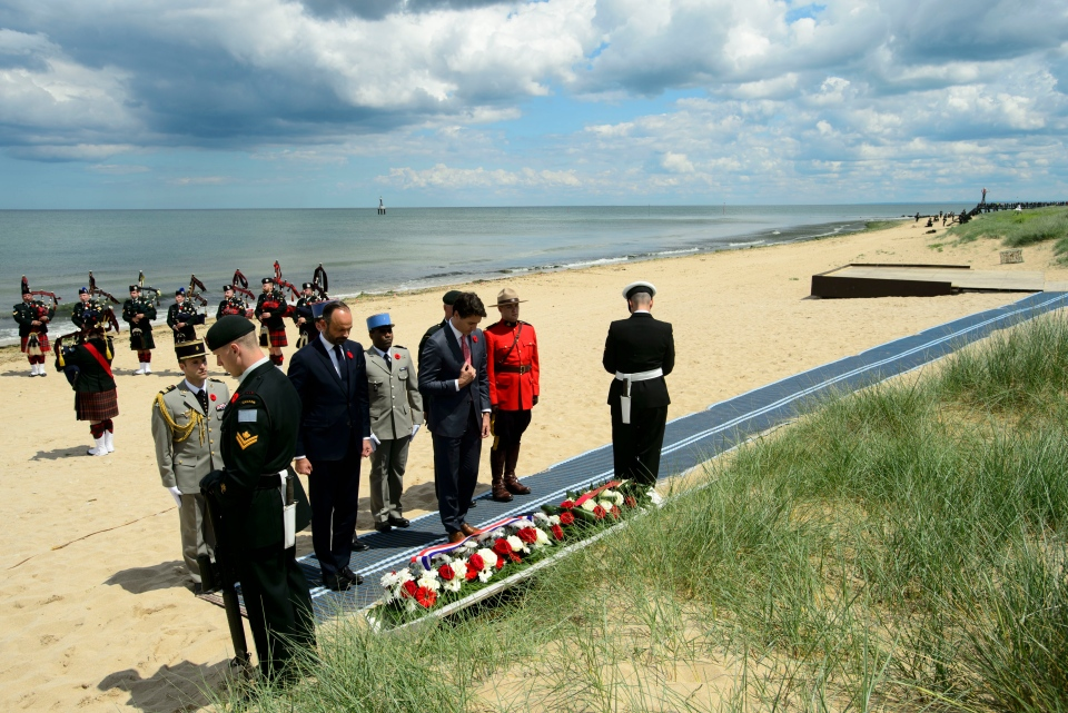 Prime Minister Justin Trudeau and the Prime Minister of France Edouard Philippe take part in a wreath laying as part of the D-Day 75th Anniversary Canadian National Commemorative Ceremony at Juno Beach in Courseulles-Sur-Mer, France on Thursday, June 6, 2019. THE CANADIAN PRESS/Sean Kilpatrick
