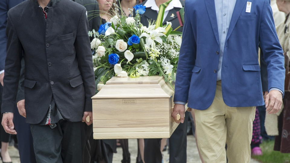 The casket of a seven-year-old girl who was found in critical condition inside of a home and later died is carried from the church after funeral services, Thursday, May 9, 2019 in Granby, Que.(THE CANADIAN PRESS/Ryan Remiorz)