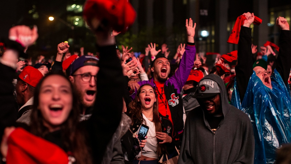 """Toronto Raptors fans react as they watch Game 3 of the NBA Final between Toronto Raptors and Golden State Warriors in """"Jurassic Park'' fanzone outside of Scotiabank Arena in Toronto on Wednesday June 5, 2019. THE CANADIAN PRESS/Chris Young"""