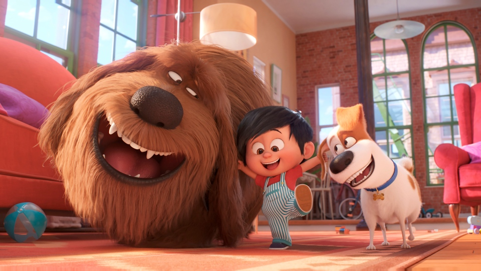"This image released by Universal Pictures shows, from left, Duke, voiced by Eric Stonestreet, Liam, voiced by Henry Lynch and Max, voiced by Patton Oswalt in a scene from ""The Secret Life of Pets 2."" (Illumination Entertainment/Universal Pictures via AP)"