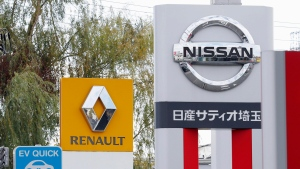 This Nov. 20, 2018, photo shows the logos of Nissan Motor Co. and Renault at car dealerships in Kawaguchi, north of Tokyo. (Takuya Inaba/Kyodo News via AP)