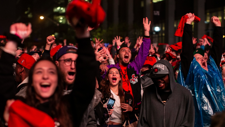 "Toronto Raptors fans react as they watch Game 3 of the NBA Final between Toronto Raptors and Golden State Warriors in ""Jurassic Park'' fanzone outside of Scotiabank Arena in Toronto on Wednesday June 5, 2019. THE CANADIAN PRESS/Chris Young"