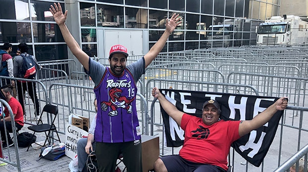 Onkar and Bobby Gill (from left to right) are seen waiting for Jurassic Park to open in Toronto ahead of Game 4 on June 7, 2019. (CTV News Toronto / Corey Baird)