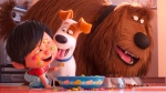 This image released by Universal Pictures shows Liam, voiced by Henry Lynch, from left, Max, voiced by Patton Oswalt, Duke, voiced by Eric Stonestreet in a scene from 'The Secret Life of Pets 2.' (Illumination Entertainment/Universal Pictures via AP)