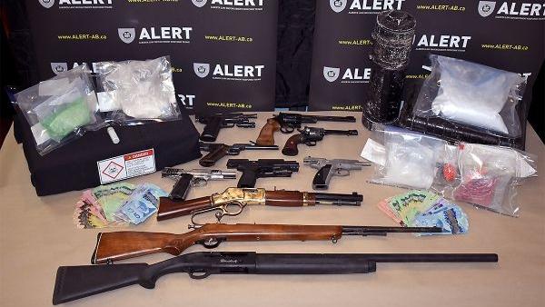 A dozen guns, body armour seized in Alberta drug bust