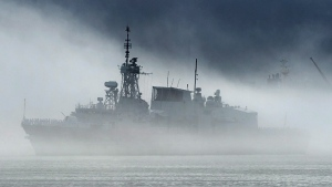 HMCS St. John's, one of Canada's Halifax-class frigates, heads through the fog as it returns to port in Halifax on Monday, July 23, 2018. Ottawa will spend $183 million on the upgrading and maintaining of underwater sensors for the Royal Canadian Navy's frigates. (THE CANADIAN PRESS/Andrew Vaughan)