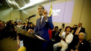 Venezuela's opposition leader and self-proclaimed interim president Juan Guaido delivers a speech during a meeting with supporters at a hotel in Valencia, Venezuela, June 7, 2019. (AP Photo/Juan Carlos Hernandez)