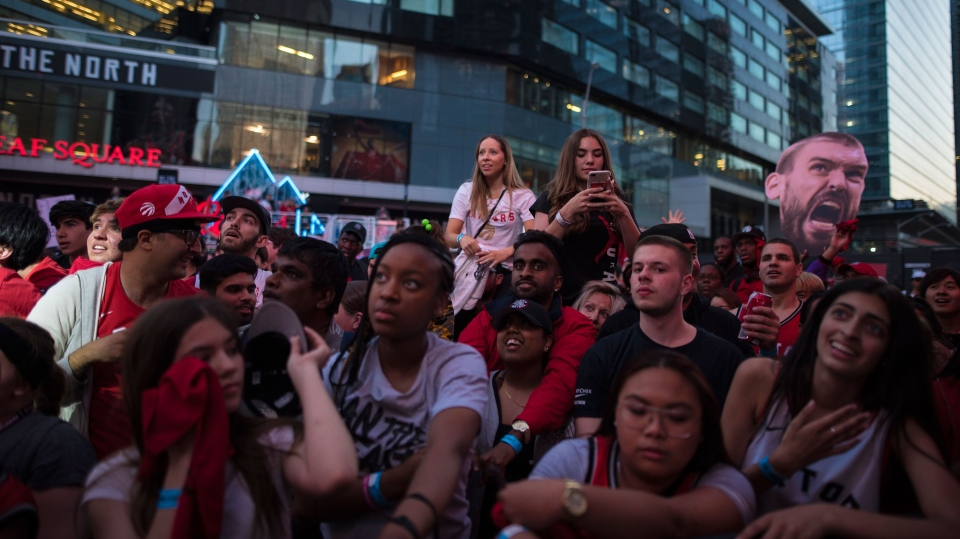 "Raptors fans gather in the ""Jurassic Park'' fanzone outside of Scotiabank Arena ahead of Game 4 of the NBA Final between Toronto Raptors and Golden State Warriors in Toronto on Friday June 7, 2019. (THE CANADIAN PRESS/ Tijana Martin)"