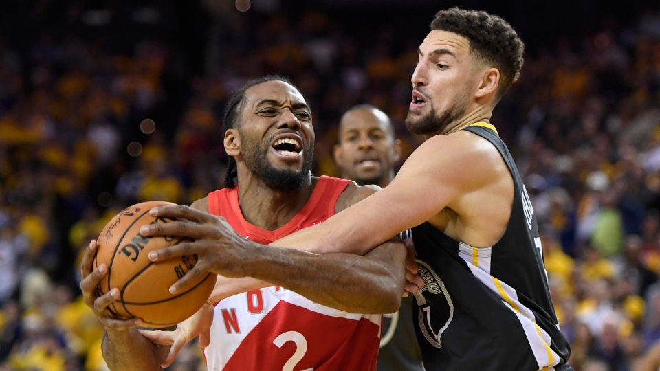 Toronto Raptors forward Kawhi Leonard (2) battles Golden State Warriors guard Klay Thompson (11) during second half basketball action in Game 4 of the NBA Finals in Oakland, California on Friday, June 7, 2019. (THE CANADIAN PRESS/Frank Gunn)