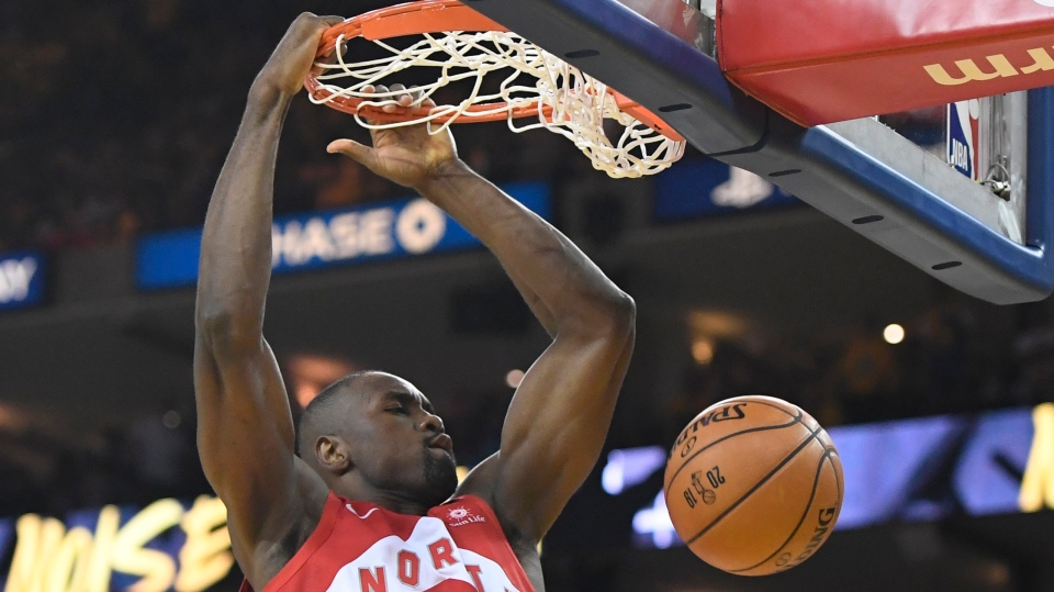 Toronto Raptors centre Serge Ibaka (9) dunks during second half basketball action against th eGolden State Warriors in Game 4 of the NBA Finals in Oakland, California on Friday, June 7, 2019. THE CANADIAN PRESS/Frank Gunn