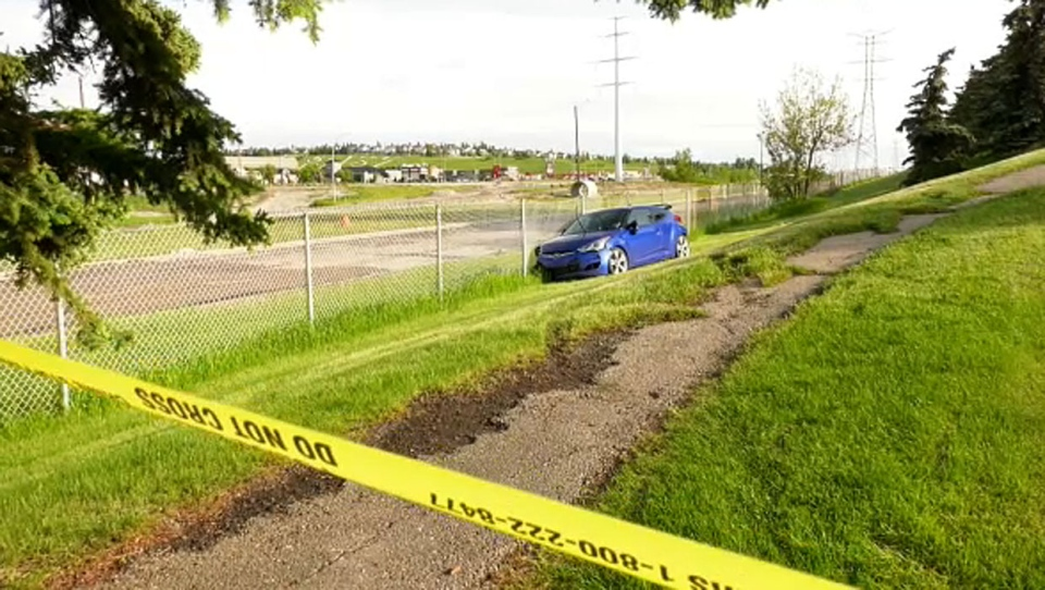 Police are working to determine how the vehicle ended up against the fence, where there is no road access.