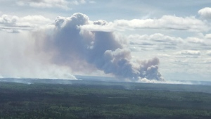 Helicopters with buckets and heavy equipment were working on the southeast side of SWF-049, a 255,000-hectare fire near Slave Lake, on June 7. (Courtesy: Alberta Wildfire)